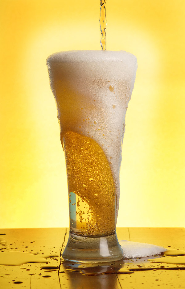 Beer Overflowing A Glass