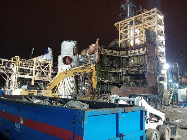 Night demolition of tank during plant shutdown