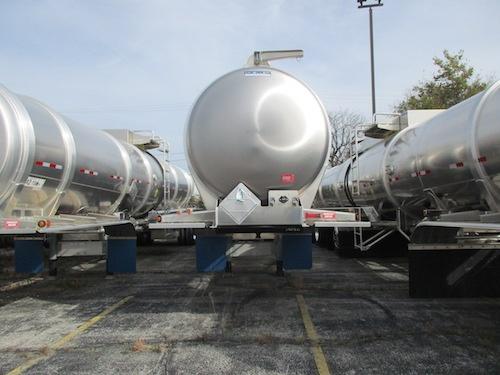 Row of crude oil tank trailers